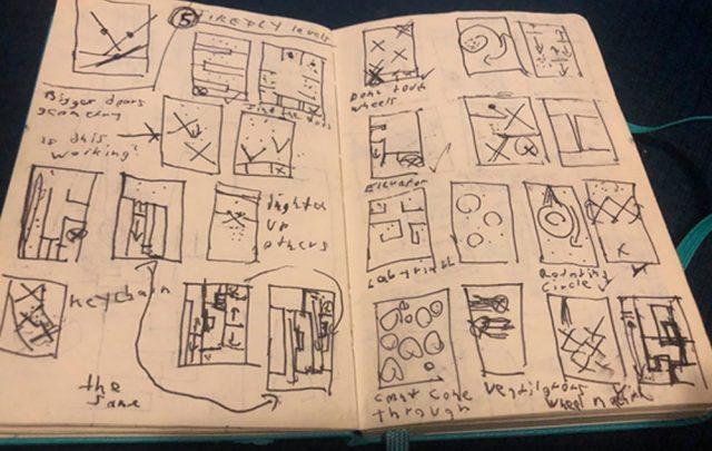 caderno com rascunhos dos mapas do jogo